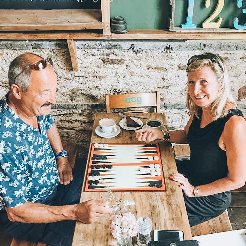 Couple enjoying coffee and a game at the Schoolhouse